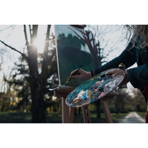 photo of artist painting outdoors